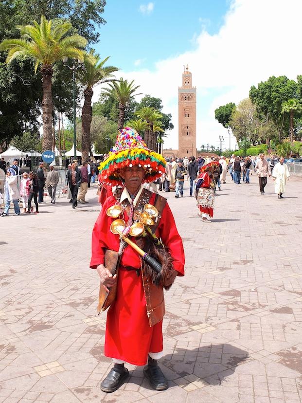 Marrakesch  -  Wasserverkäufer, Jemaa El Fnaa, Moschee Koutoubia